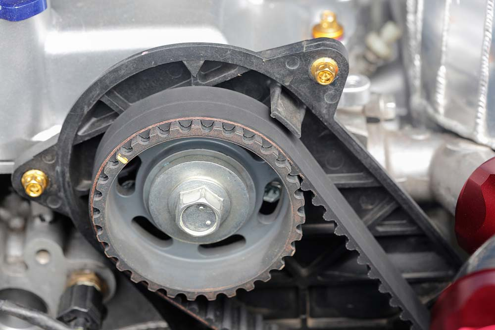 timing belt and camshaft sprocket in a car
